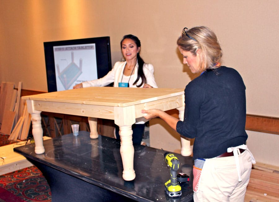 Jen Woodhouse and Jaime Costiglio build a coffee table at the Haven Conference