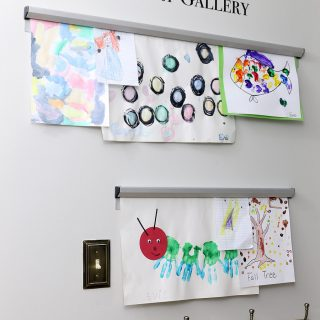 How to display kids artwork - easily change out art with ticket hangers. Brilliant!