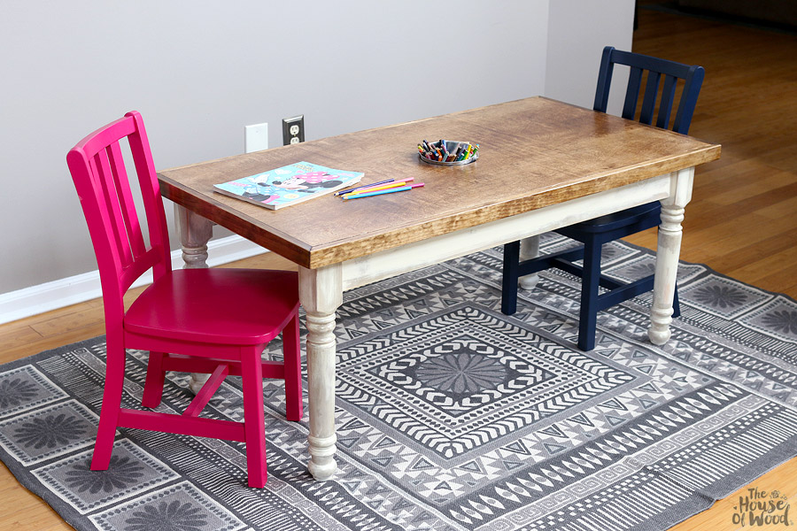 How to build a kids farmhouse table with storage for art supplies and hidden cubbies! Via Jen Woodhouse