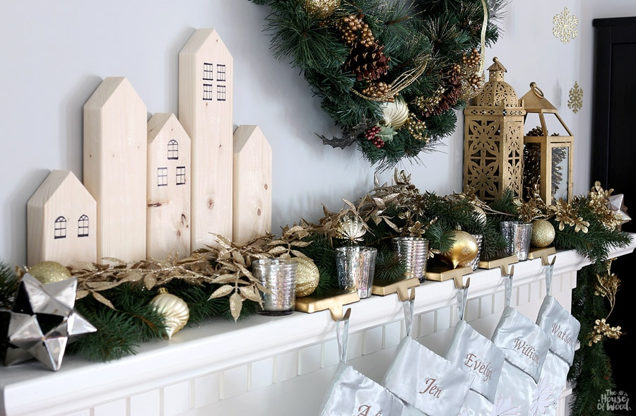 Christmas mantel with scrap wood houses via Jen Woodhouse
