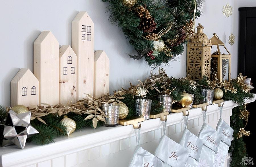 Christmas mantel with scrap wood houses via Jen Woodhouse