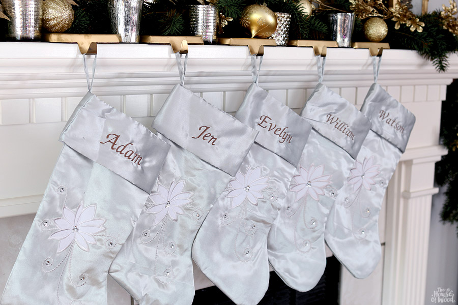 Christmas mantel with embroidered stockings via Jen Woodhouse
