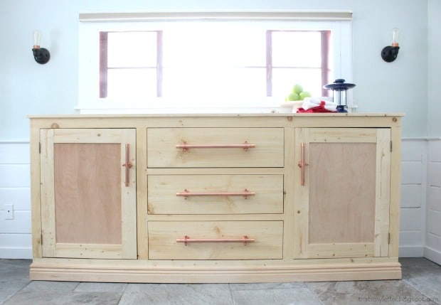 Natural wood and copper sideboard by That's My Letter