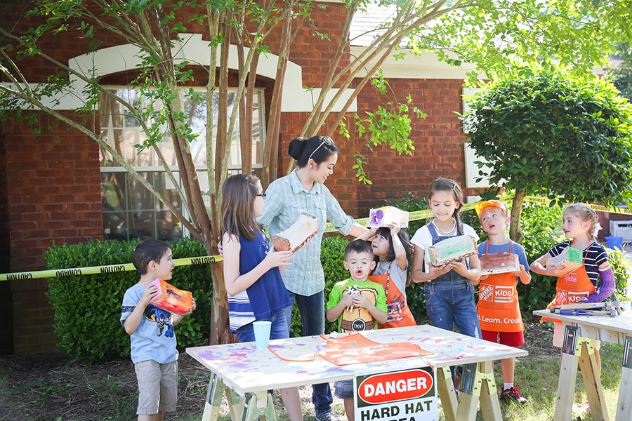 What a fun construction themed birthday party! Kids can build things with workshop kits from Home Depot!