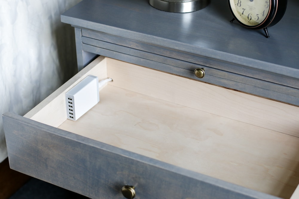 Genius! LOVE this DIY nightstand with built-in charging station and pull-out writing tray. Free plans by Jen Woodhouse