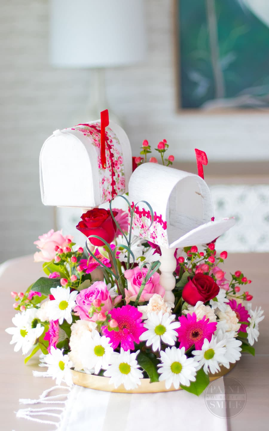 Easy DIY Valentine's Mailboxes made from fabric, cardboard, and wooden candle sticks.