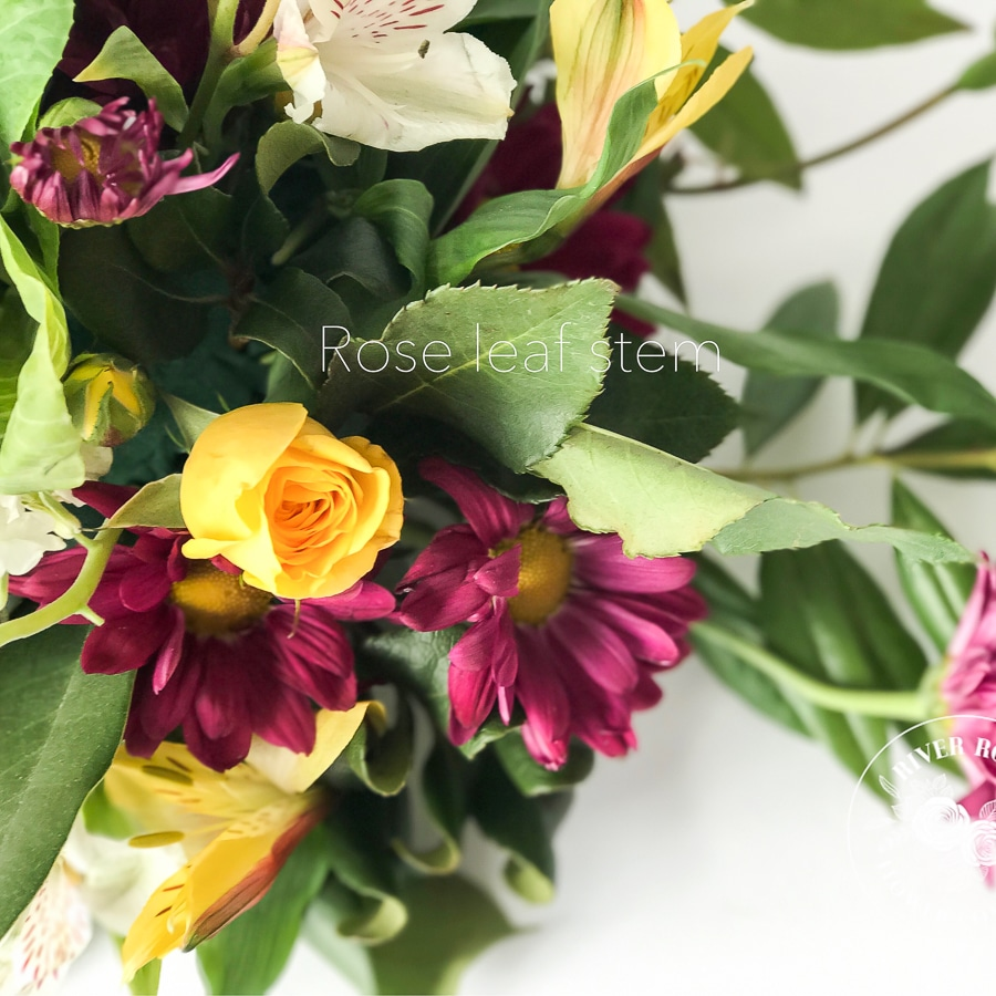 Designer centerpiece using grocery store flowers and garden scraps