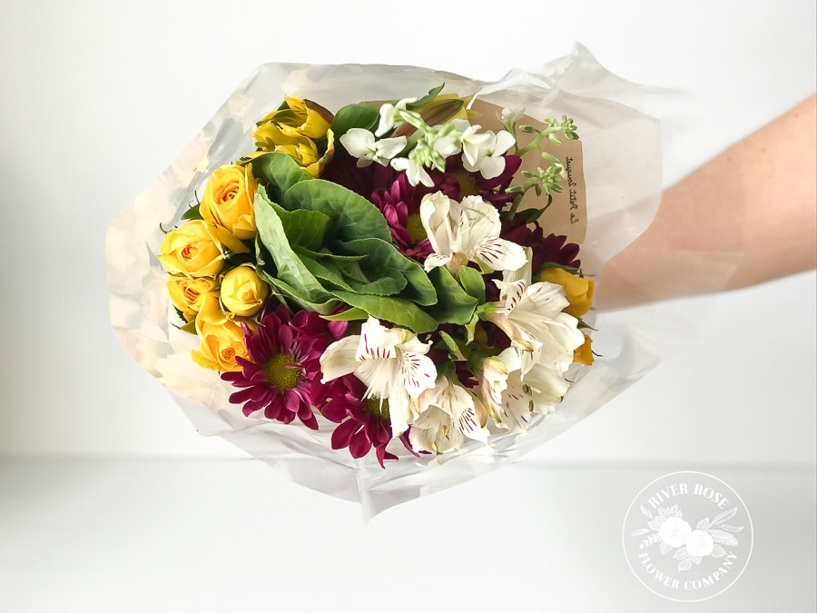 Make a centerpiece with grocery store flowers