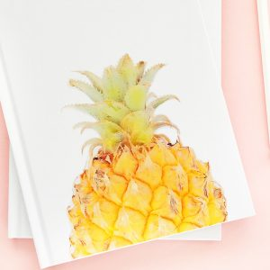 DIY Pineapple Notebook - Create your own tropical stationery with this tutorial using printable temporary tattoo paper. Click through for the how-to!