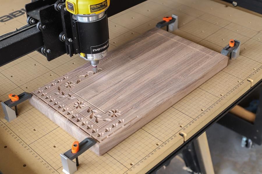 Carving a beautiful pattern into the black walnut cutting board