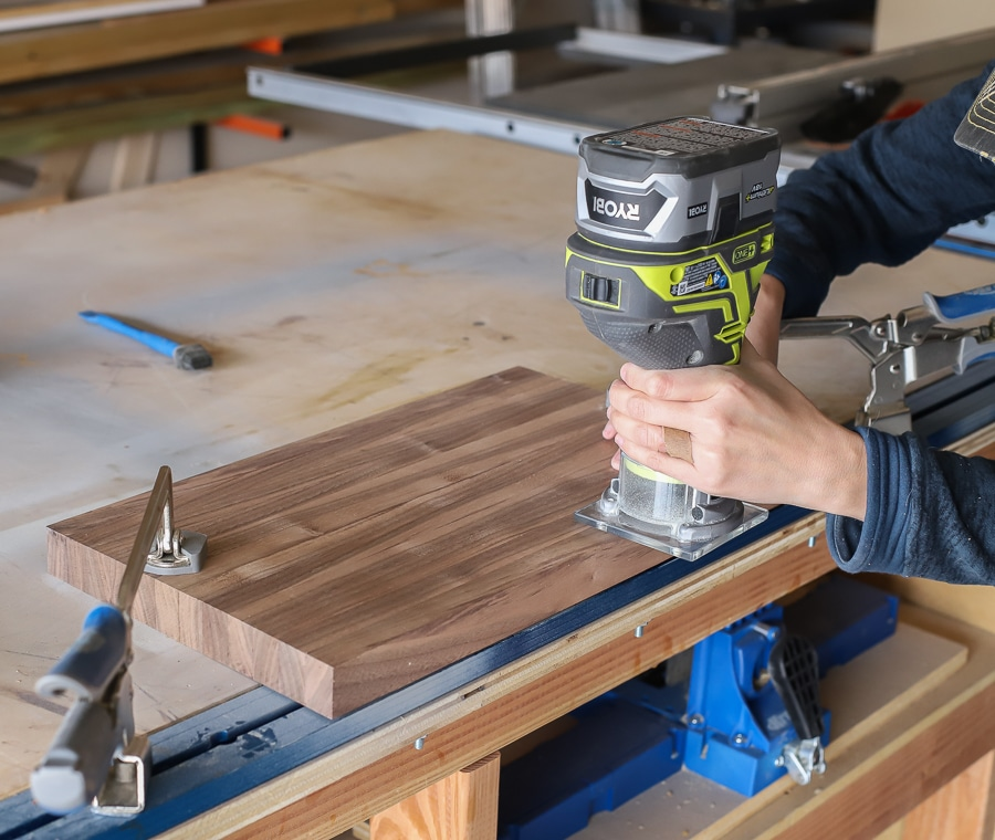 Using the roundover router bit to round the edges of the cutting board