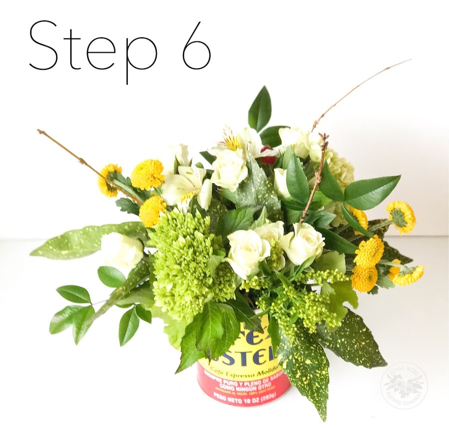 Use common vessels, like coffee cans, to arrange your flowers.