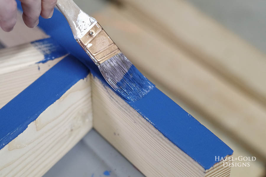 Easy DIY Outdoor Bench - Paint leg sections dark blue