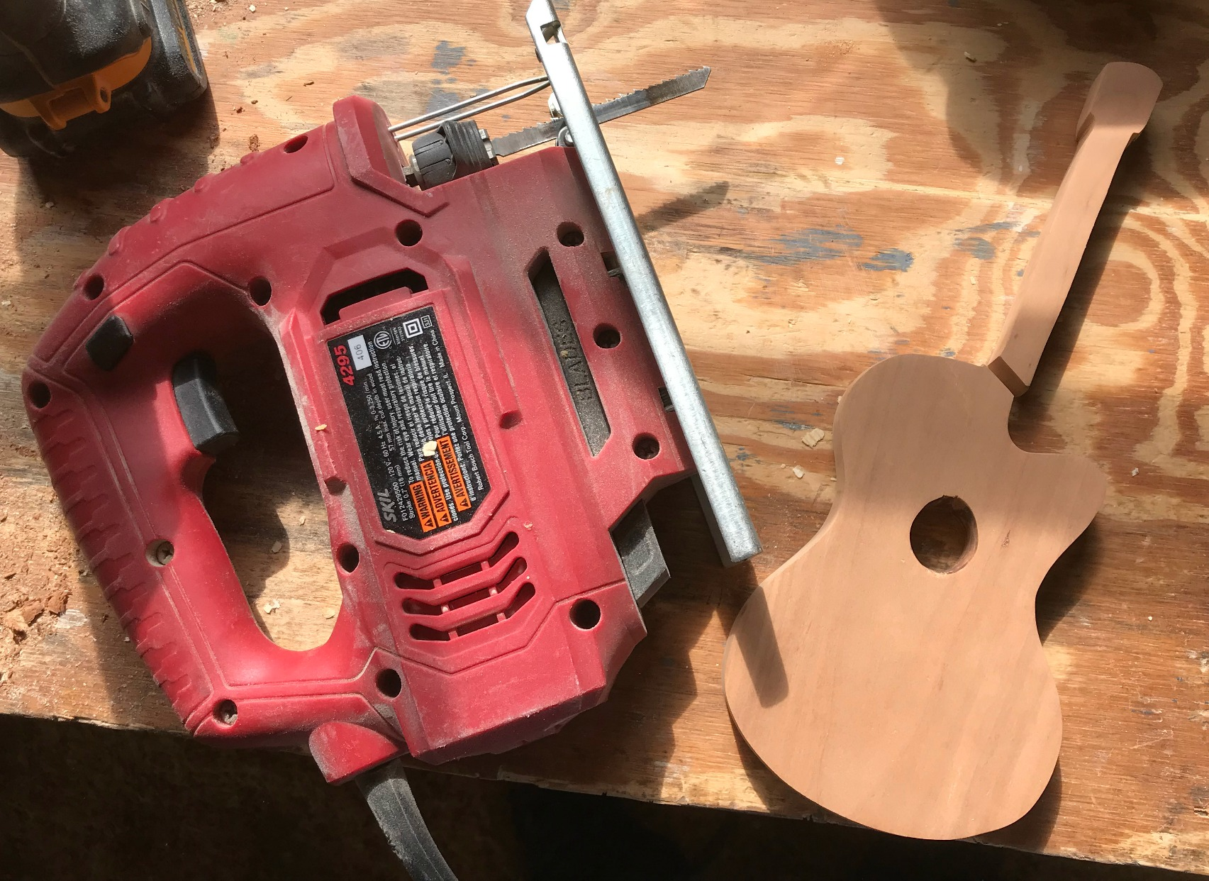 Cut Guitar in half to create two bookend sides