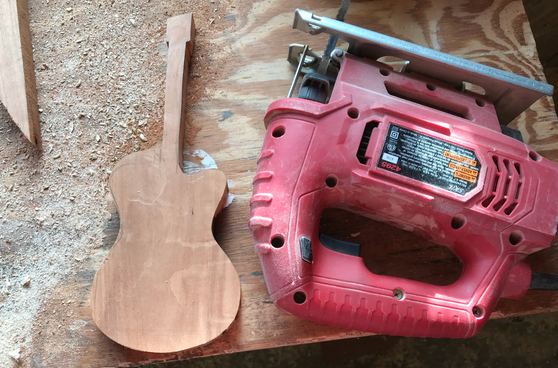 Use jig saw to cut scrap wood into Guitar shape
