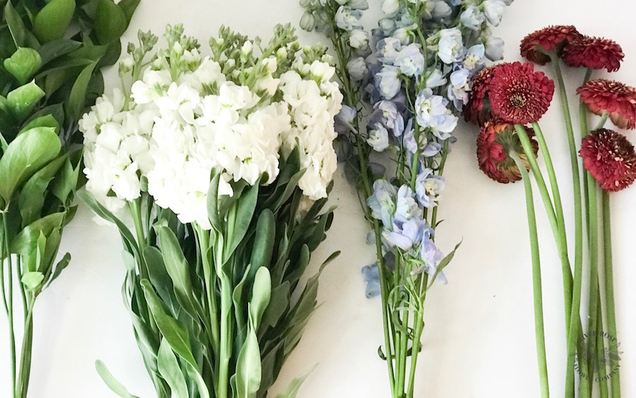 Patriotic flowers: red gerber daisies, white, and blue delphinium