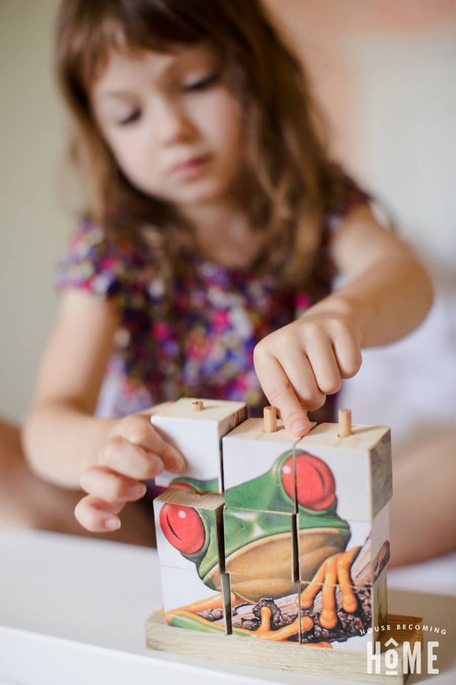 playing with stacking wood puzzle