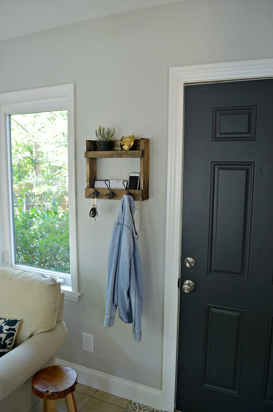 Rustic wall mounted shelves with coat hooks
