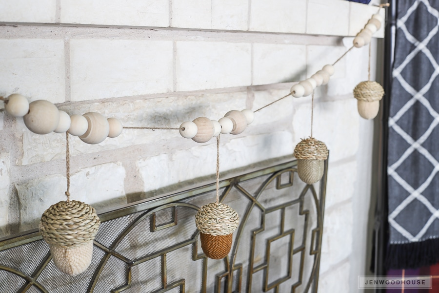 How to make a DIY acorn garland to decorate the mantel for Autumn