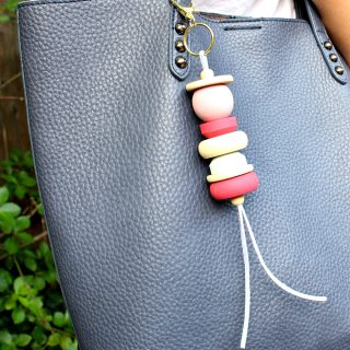 painted wood and leather purse bag tassel