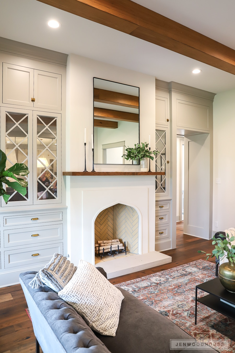 The Living Room With That Charming Fireplace And Cabinetry: