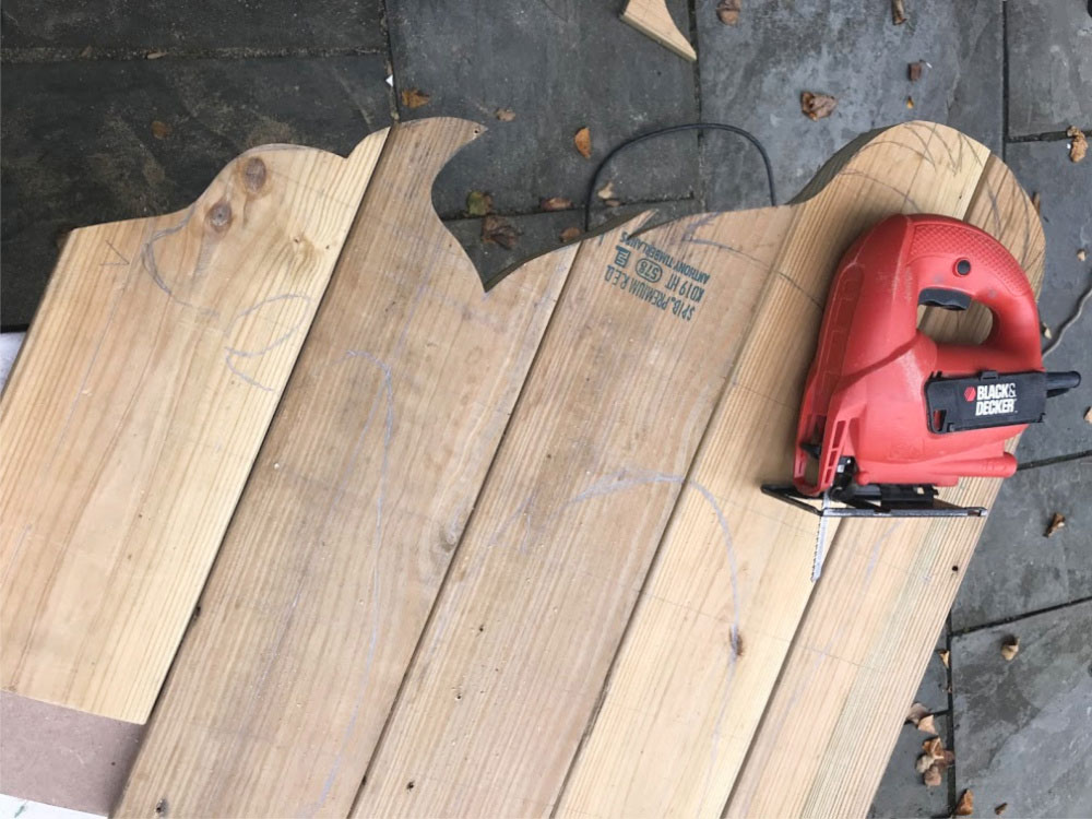cutting out wood shape with jigsaw