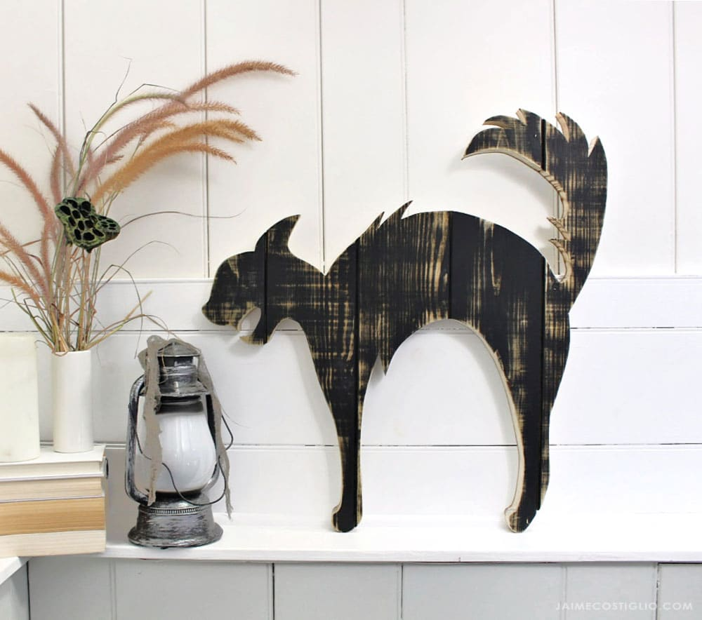 large black cat wood cut out on ledge