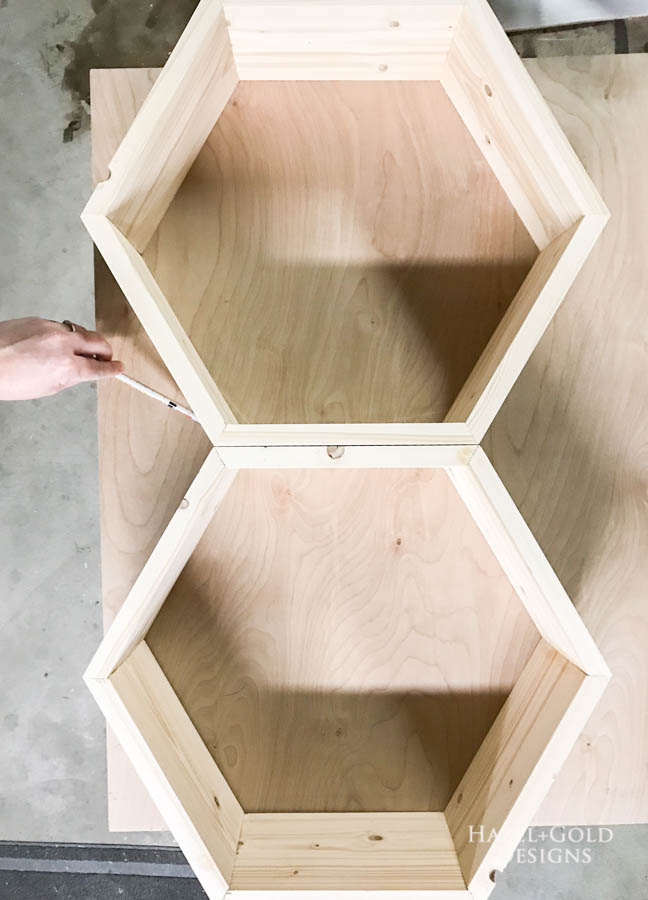 DIY Hexagon Shelf for Craft Storage- Trace hexagons to get correct size for backing