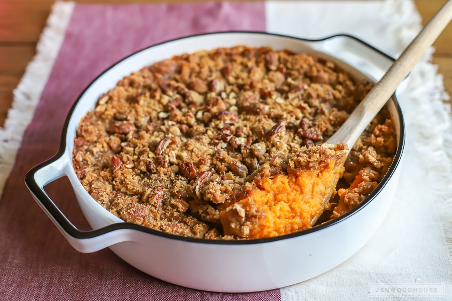 The BEST sweet potato casserole recipe! Creamy and rich sweet potatoes with a crumbly brown sugar pecan crust!