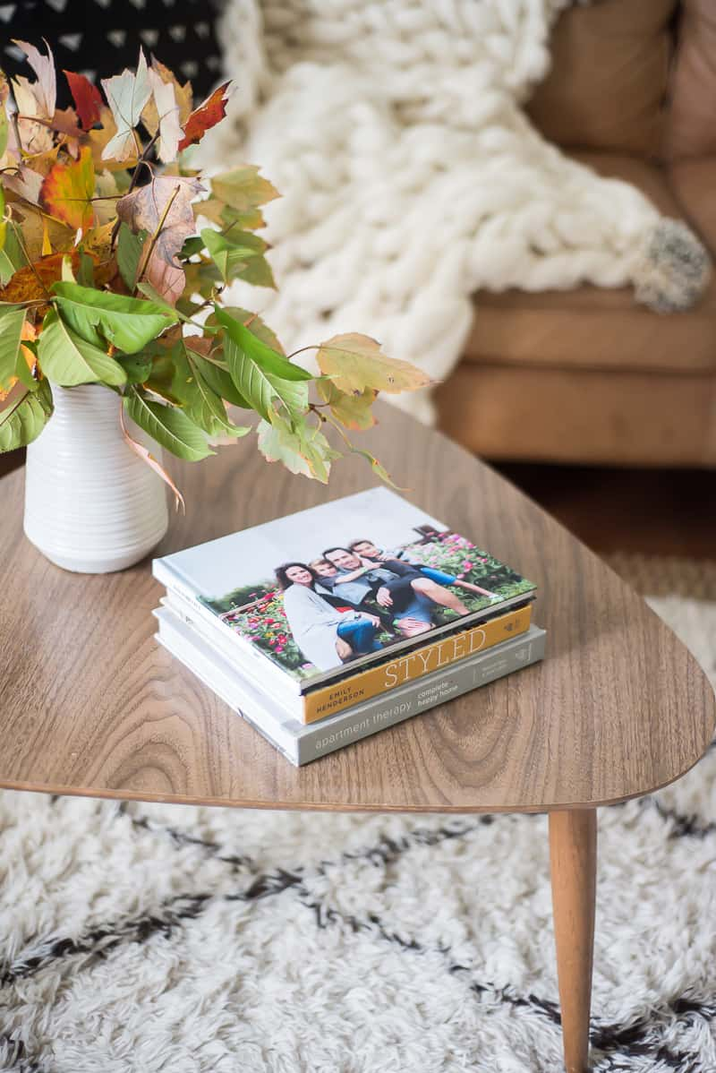 family photo book displayed on mid century coffee table