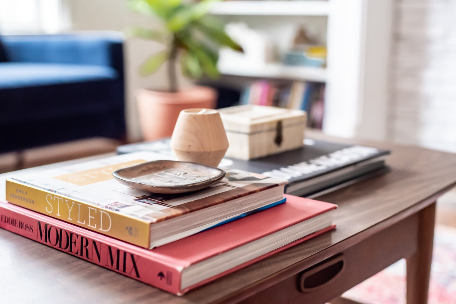 stacked books on mid century coffee table