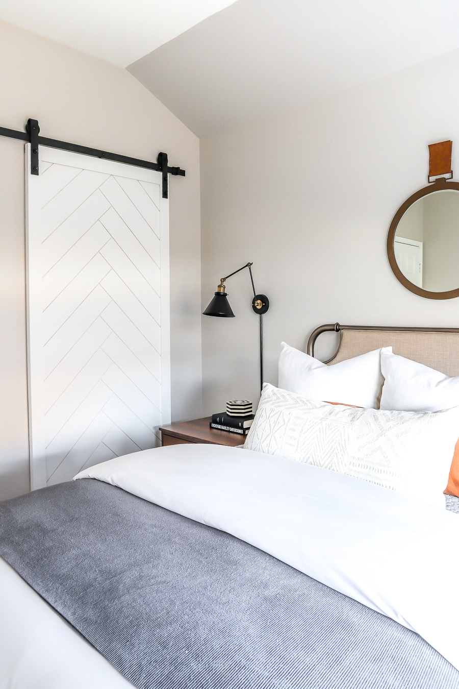 Herringbone sliding barn door in guest room
