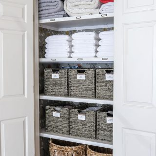 How to organize a linen closet - check out this linen closet makeover!