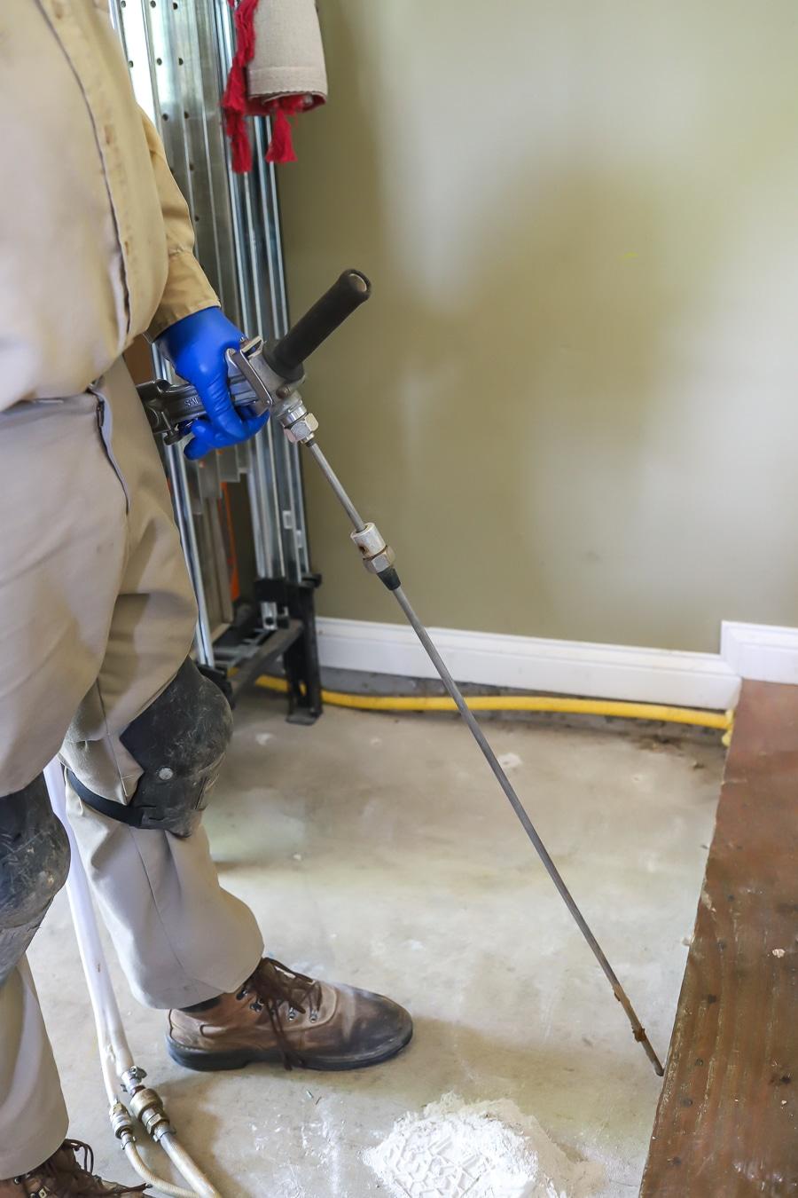 Applying Orkin Pest control termite treatment