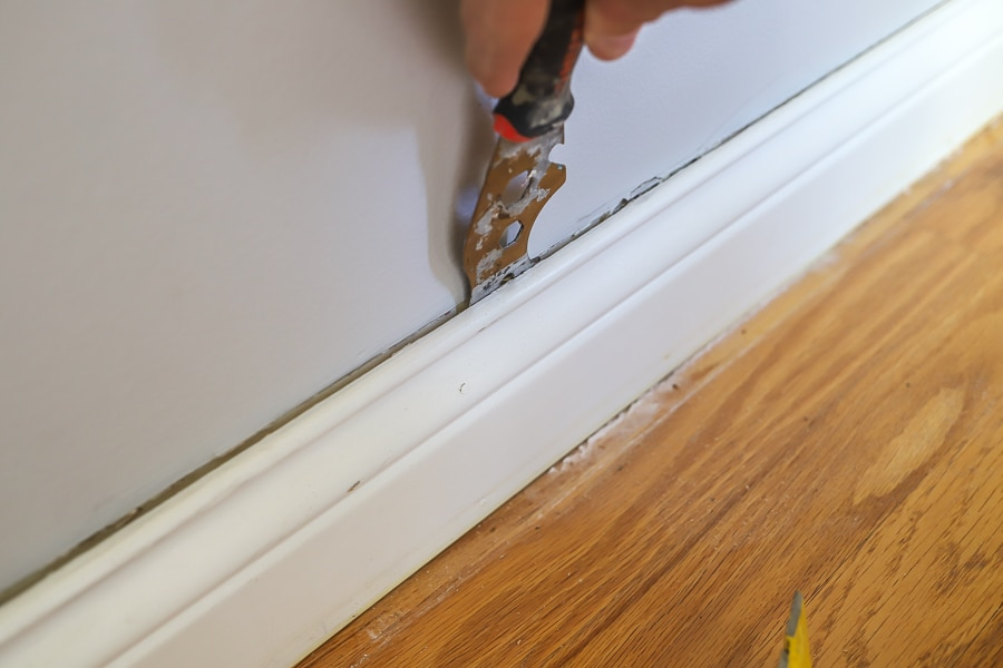 Score the baseboards with a knife or multitool