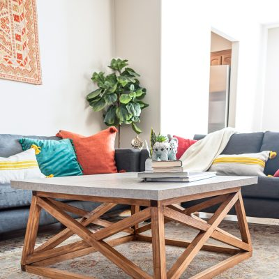 How to build a DIY Angled X Base Coffee Table with a Concrete Top - Free plans!