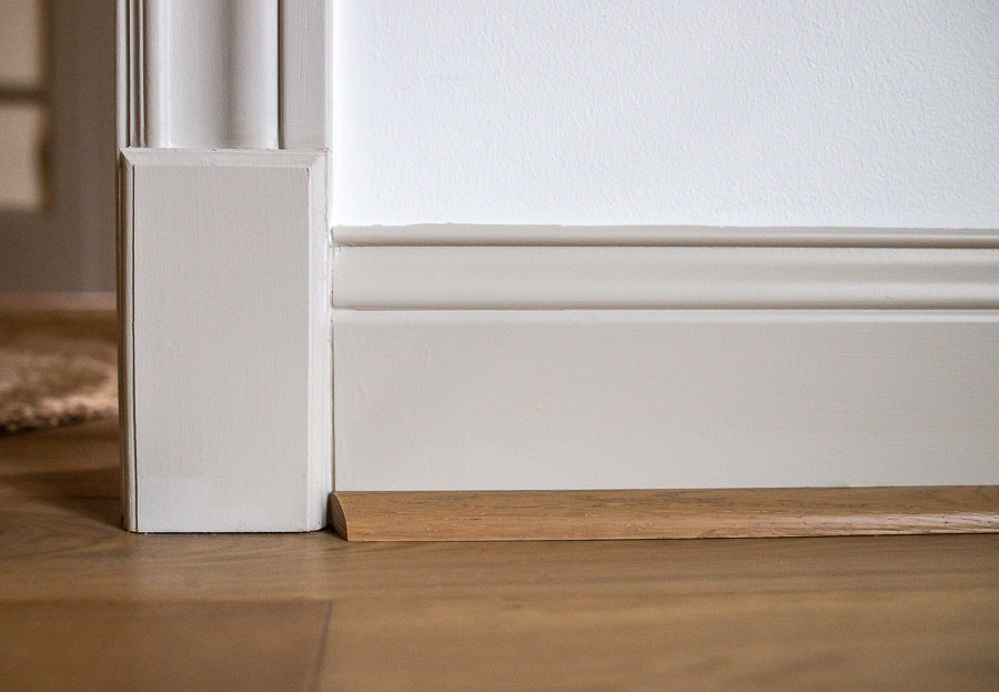 Transition a door casing to baseboard with a plinth block