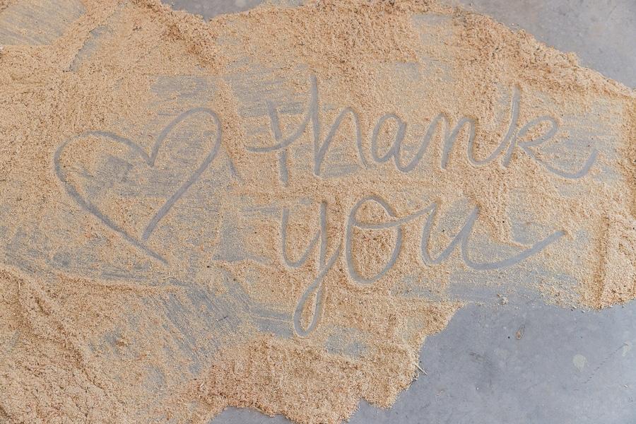 thank-you-written-in-sawdust