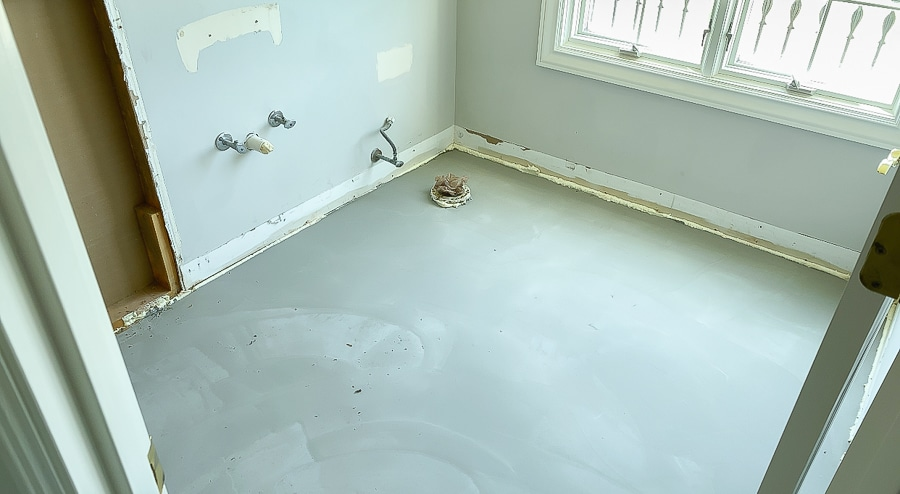 Self-leveling underlayment poured over wood subfloor