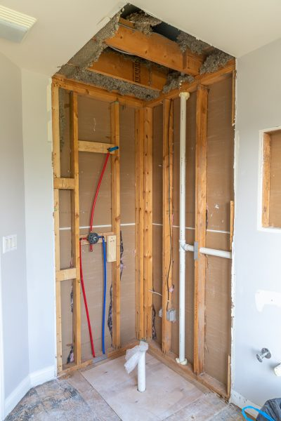 Guest bathroom renovation plumbing rough-in and floor leveling