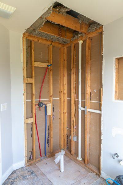 Guest bathroom renovation plumbing rough-in and floor leveling