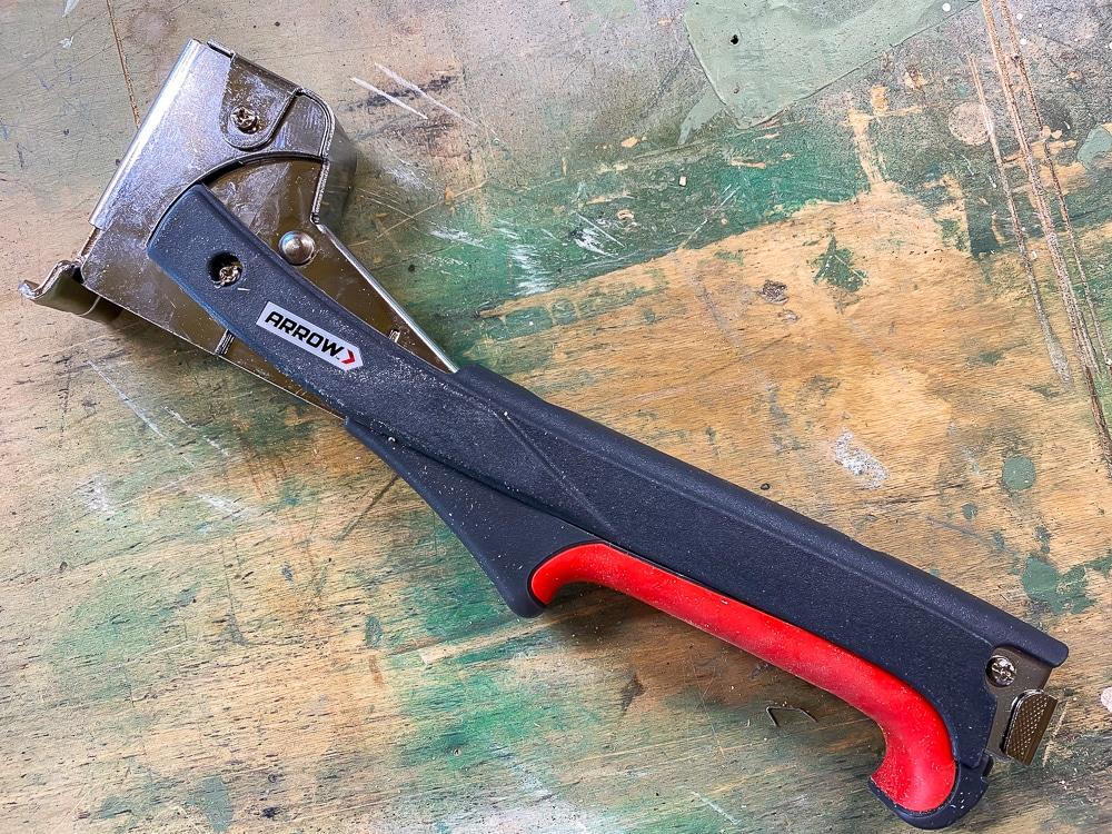 How to hang batt insulation with a hammer tacker