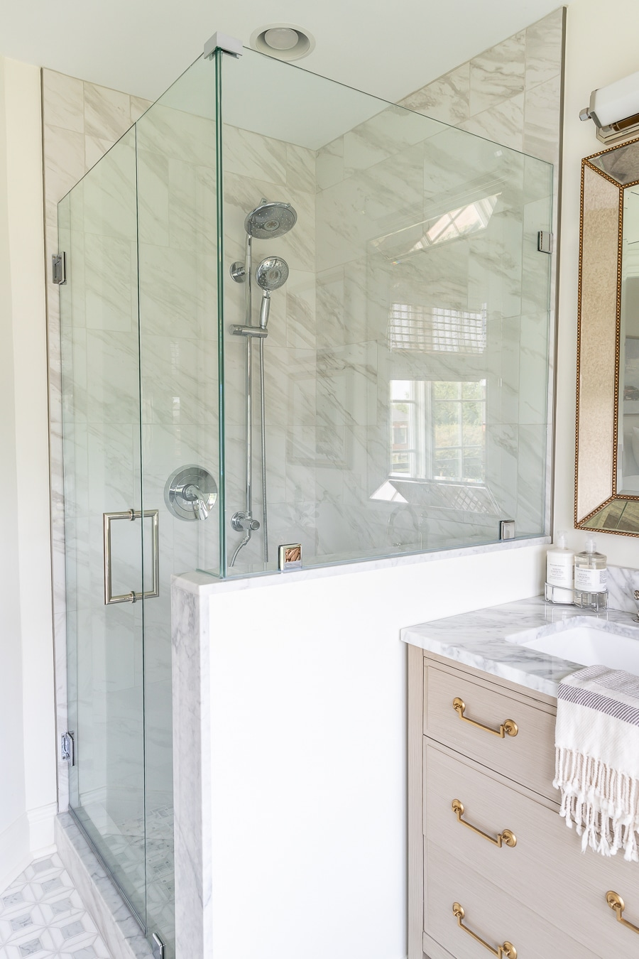 Gorgeous bathroom renovation with marble tile and glass shower