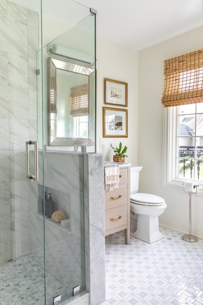 Stunning guest bathroom renovation featuring marble mosaic tile and vintage accents