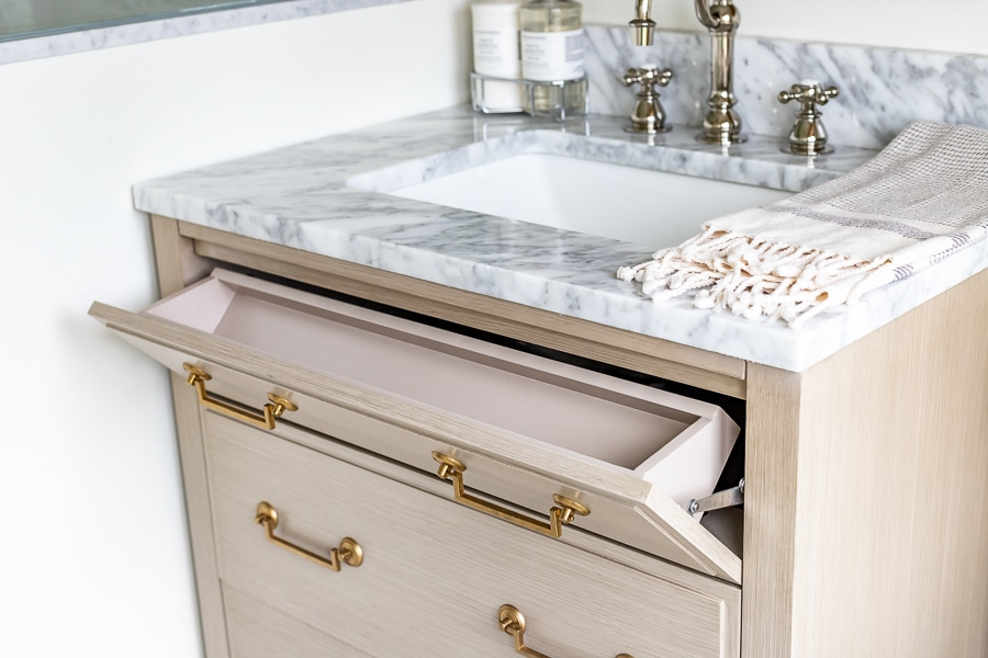 Guest bathroom renovation with storage vanity