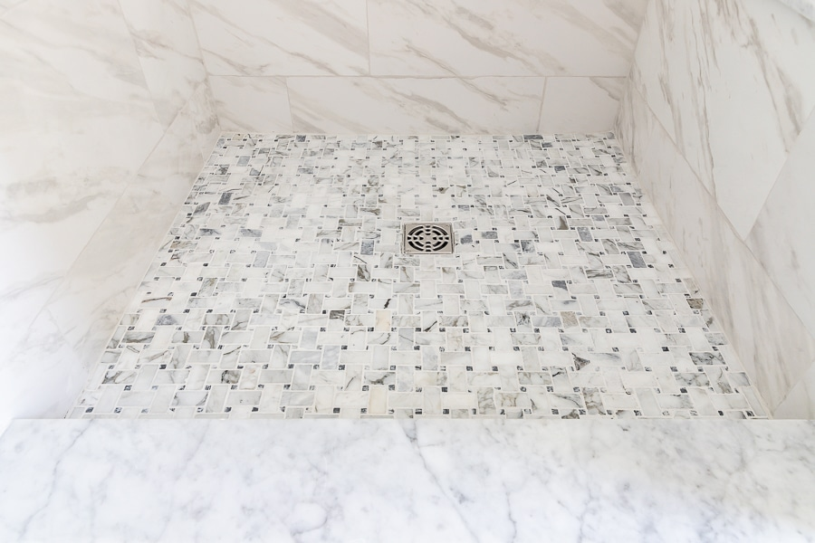 Basketweave marble mosaic tile on shower floor