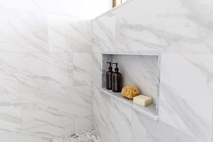 Large format tile on shower walls with niche