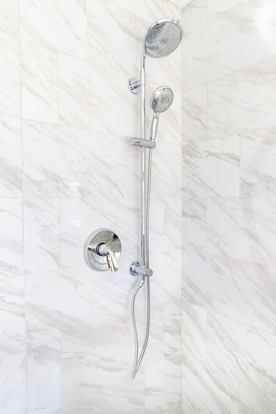 Large format tiles on shower wall with shower system