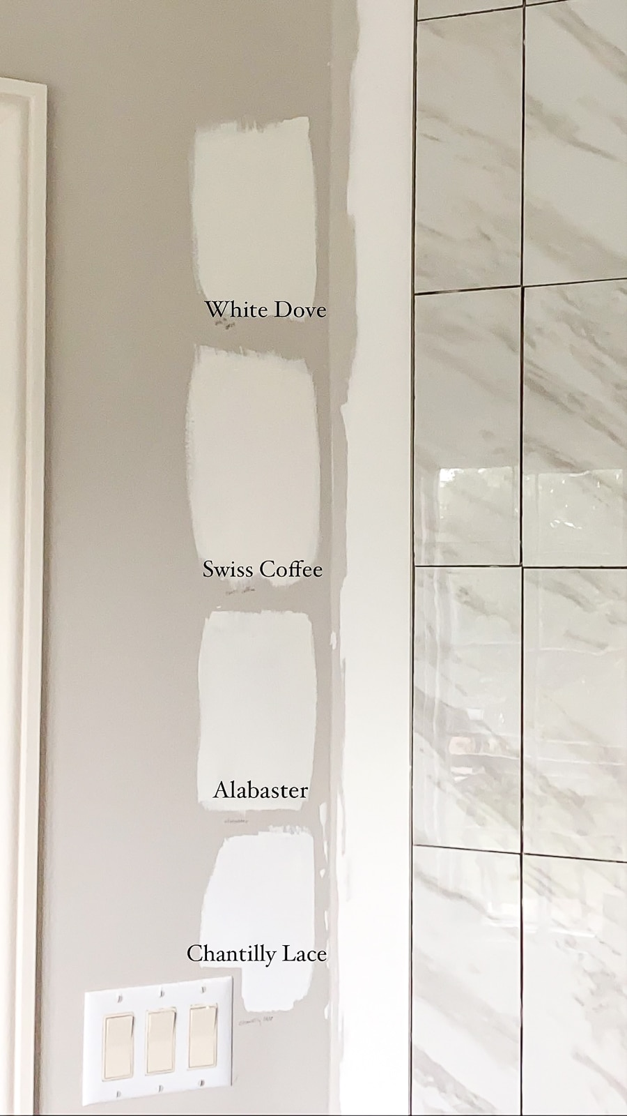 White paint swatches in the bathroom