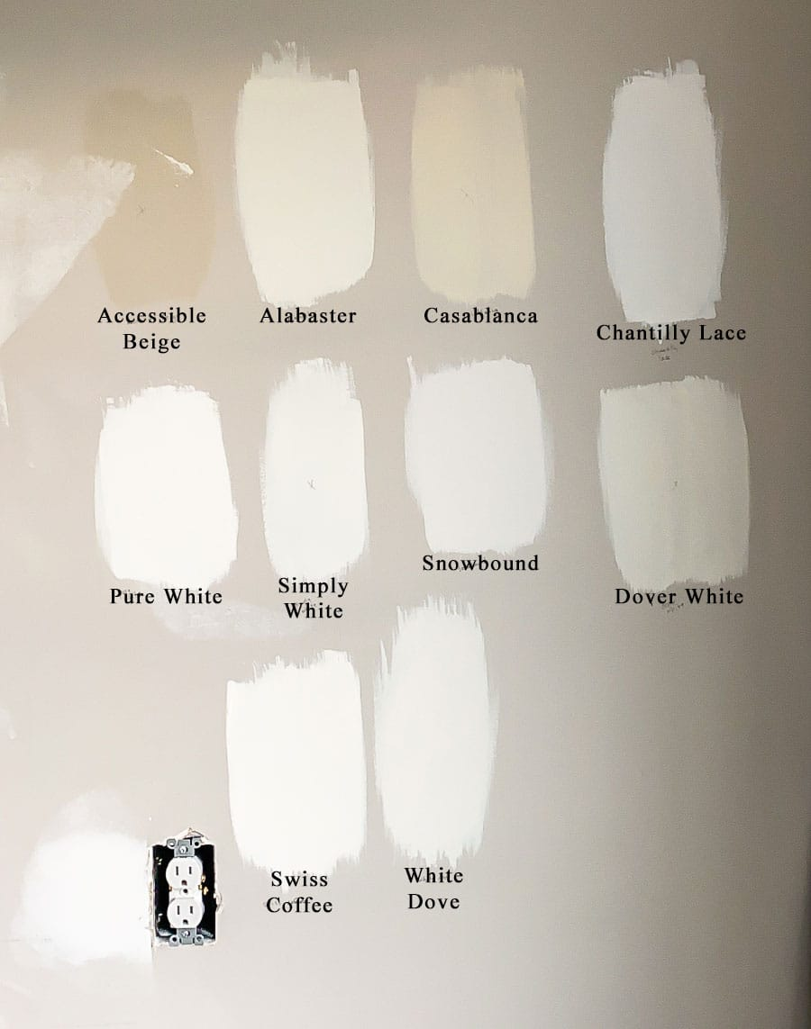 Testing white paint colors in the bathroom